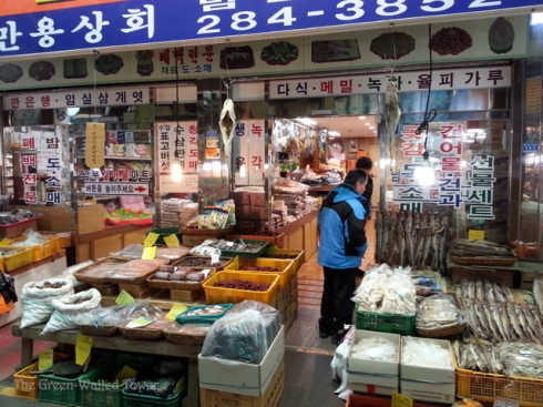 This shop sells a bunch of everything. The signs advertise dried persimmons, buckwheat, deer antler, green tea, etc.