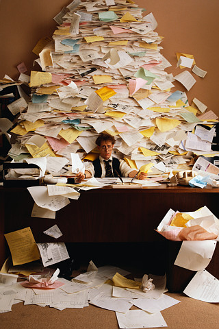 Businessman Buried in Paperwork --- Image by © Royalty-Free/Corbis